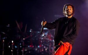 Kendrick Lamar staring at the camera mid performance