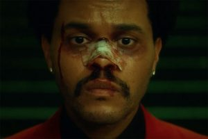 The Weeknd bloodied up in a screenshot from a music video