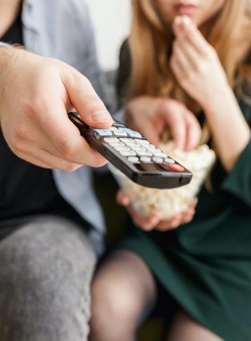 man holding a tv controller