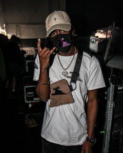 Black$tar posing by sound equipment
